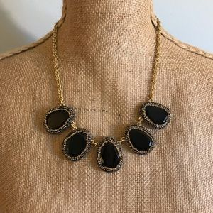 Classy simple black w/ gold necklace.